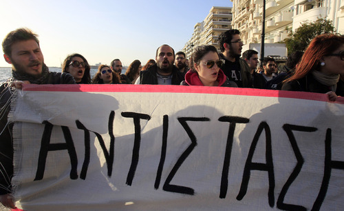 Cypriot university students hold a banner reads ''Resistance'' during a rally, against a plan to seize a part of depositors' bank savings, outside Cyprus' Consulate in the northern Greek port city of Thessaloniki, Tuesday, March 19, 2013. The Cypriot government sought Tuesday to shield small savers from a plan that is intended to raise euro 5.8 billion ($7.5 billion) toward a financial bailout by seizing money from bank accounts. The plan, which is part of a larger bailout package being negotiated with other European countries, has been met with fury in Cyprus and has sent jitters across financial markets. (AP Photo/Nikolas Giakoumidis)