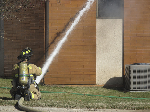 Jessica Miller  |  The Salt Lake Tribune Fire crews from several Davis County agencies work to fight a blaze sparked Tuesday afternoon in the basement of Clearfield Community Church, 200 S. 500 East, Clearfield.