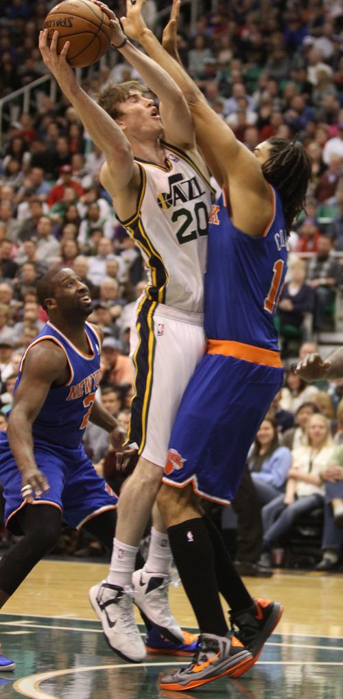 Rick Egan  | The Salt Lake Tribune   Utah Jazz shooting guard Gordon Hayward (20) goes up for a shot, as New York Knicks small forward Chris Copeland (14) defends, in NBA action, Utah Jazz vs. The New York Knick's, at Energy Solutions Arena, Monday, March 18, 2013.