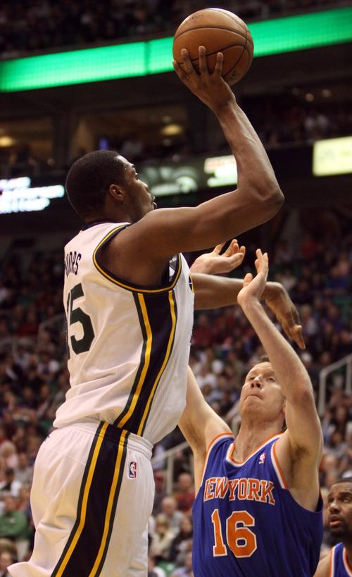 Rick Egan  | The Salt Lake Tribune   Utah Jazz power forward Derrick Favors (15) shoots overNew York Knicks small forward Steve Novak (16), in NBA action, Utah Jazz vs. The New York Knick's, at Energy Solutions Arena, Monday, March 18, 2013.