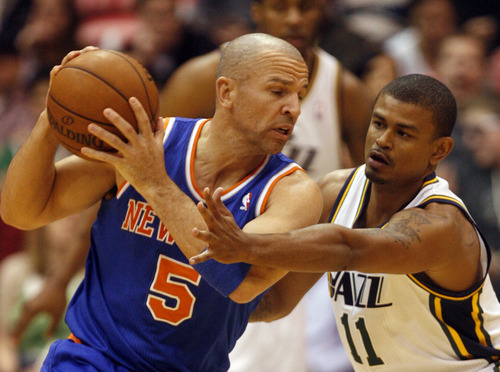 Rick Egan  | The Salt Lake Tribune   Utah Jazz point guard Earl Watson (11) tried to keep New York Knicks point guard Jason Kidd (5) from taking the ball inside during a game Monday, March 18, 2013 in Salt Lake City.