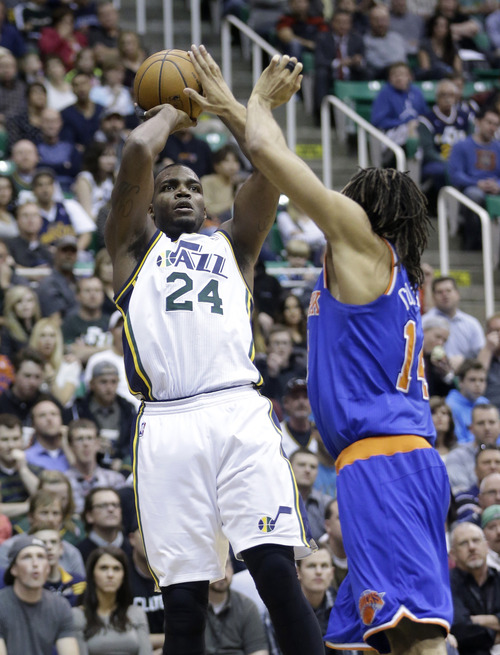 Utah Jazz's Paul Millsap (24) shoots as New York Knicks' Chris Copeland (14) defends in the first half during an NBA basketball game Monday, March 18, 2013, in Salt Lake City.  (AP Photo/Rick Bowmer)