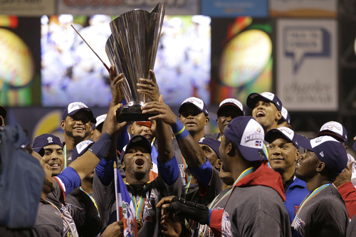 The Dominican Republic players raise the trophy after beating Puerto Rico in the championship game of the World Baseball Classic in San Francisco, Tuesday, March 19, 2013. The Dominican Republic won 3-0. (AP Photo/Ben Margot)