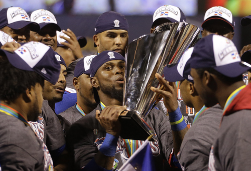 The Dominican Republic's Jose Reyes, center, celebrates with teammates after beating Puerto Rico in the championship game of the World Baseball Classic in San Francisco, Tuesday, March 19, 2013. The Dominican Republic won 3-0. (AP Photo/Ben Margot)