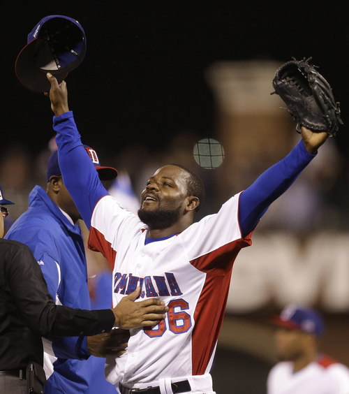 The Dominican Republic's Fernando Rodney (56) celebrates after the Dominican Republic beat Puerto Rico in the championship game of the World Baseball Classic in San Francisco, Tuesday, March 19, 2013. The Dominican Republic won 3-0. (AP Photo/Ben Margot)