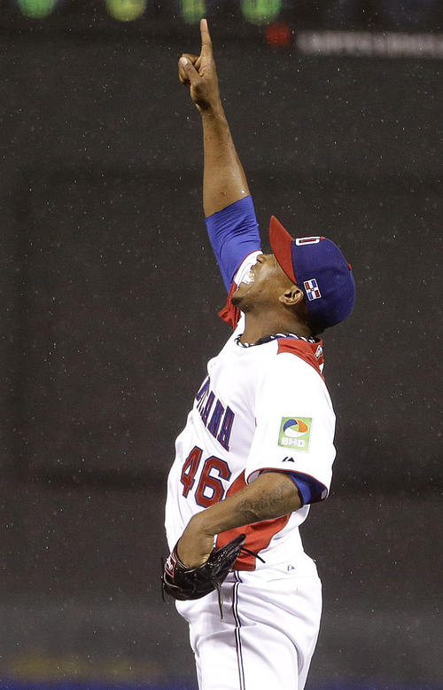 The Dominican Republic's Pedro Strop (46) celebrates the last out of the seventh inning of the championship game of the World Baseball Classic against Puerto Rico in San Francisco, Tuesday, March 19, 2013. (AP Photo/Ben Margot)