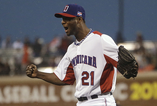 Dominican Republic's Samuel Deduno celebrates after striking out Puerto Rico's Angel Pagan during the fifth inning of the championship game of the World Baseball Classic in San Francisco, Tuesday, March 19, 2013. (AP Photo/Ben Margot)