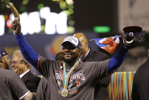 The Dominican Republic's Fernando Rodney holds up a plantain as he celebrates after the championship game of the World Baseball Classic against Puerto Rico in San Francisco, Tuesday, March 19, 2013. The Dominican Republic won 3-0. (AP Photo/Ben Margot)