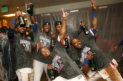 The Dominican Republic players celebrate in the locker room after beating Puerto Rico in the championship game of the World Baseball Classic in San Francisco, Tuesday, March 19, 2013. The Dominican Republic won 3-0. (AP Photo/Stephen Lam, Pool)