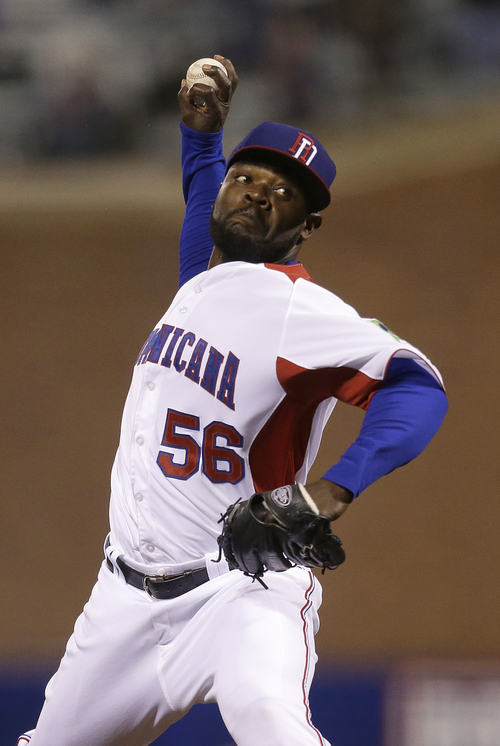 The Dominican Republic's Fernando Rodney (56) pitches against Puerto Rico during the ninth inning of the championship game of the World Baseball Classic in San Francisco, Tuesday, March 19, 2013. The Dominican Republic won 3-0. (AP Photo/Ben Margot)