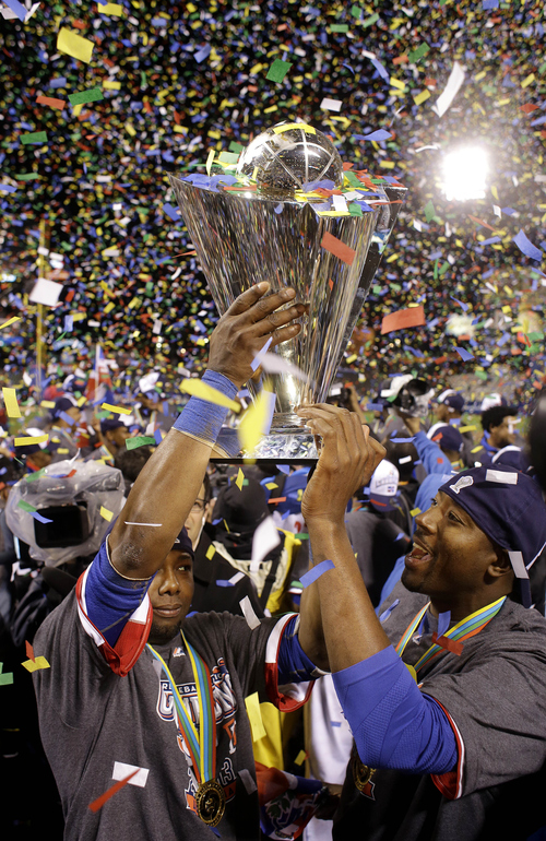 The Dominican Republic players raise the trophy after beating Puerto Rico in the championship game of the World Baseball Classic in San Francisco, Tuesday, March 19, 2013. The Dominican Republic won 3-0.  (AP Photo/Eric Risberg)