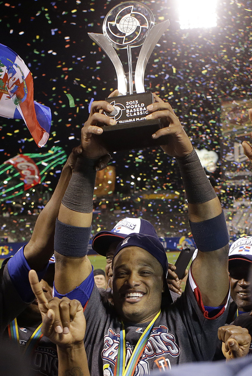 The Dominican Republic's Robinson Cano raises the MVP trophy after the championship game of the World Baseball Classic against Puerto Rico in San Francisco, Tuesday, March 19, 2013. The Dominican Republic won 3-0. (AP Photo/Eric Risberg)