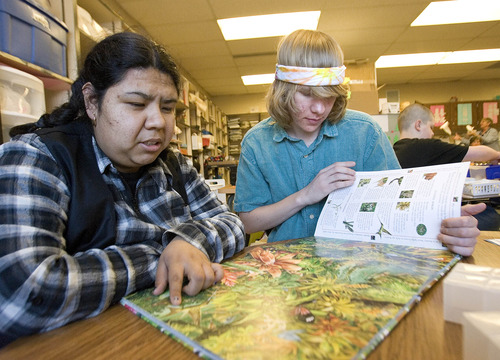Paul Fraughton  |  The Salt Lake Tribune Olympus High School student Will Cannon, right, helps Cecilia Munoz with her language skills. Will is one of several Olympus High students who volunteer at The Hartvigsen School for students with special needs.  Tuesday, March 12, 2013