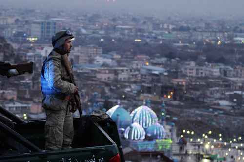 An Afghan Army soldier secures the hill overlooking the Kart-e Sakhi mosque in Kabul, Afghanistan, Wednesday, March 20, 2013. Thousands of Afghans will celebrate Nowruz on Thursday, March 21, 2013 to mark the first day of spring and the beginning of the year on the Iranian calendar. (AP Photo/Ahmad Jamshid)