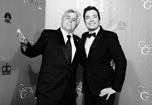 """FILE - This Jan. 13, 2013 file photo shows Jay Leno, host o f """"The Tonight Show with Jay Leno,"""" left, and Jimmy Fallon, host of """"Late Night with Jimmy Fallon"""" backstage at the 70th Annual Golden Globe Awards in Beverly Hills, Calif. As Jay Leno lobs potshots at ratings-challenged NBC in his """"Tonight Show"""" monologues, speculation is swirling the network is taking steps to replace the host with Jimmy Fallon next year and move the show from Burbank to New York.  NBC confirmed Wednesday, March 20, it's creating a new studio for Fallon in New York, where he hosts """"Late Night."""" But the network did not comment on a report that the digs at its Rockefeller Plaza headquarters may become home to a transplanted, Fallon-hosted """"Tonight Show."""" (Photo by Jordan Strauss/Invision/AP, file)"""