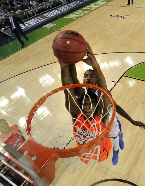 Louisville forward Chane Behanan (24) drives to the basket in front of Kentucky forward Michael Kidd-Gilchrist (14) during the first half of an NCAA Final Four semifinal college basketball tournament game Saturday, March 31, 2012, in New Orleans. (AP Photo/Chris Steppig, Pool)