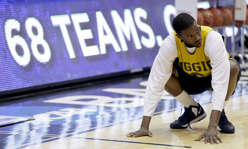 North Carolina A&T guard Jean Louisme stretches during practice for an NCAA college basketball tournament game, Monday, March 18, 2013, in Dayton. North Carolina A&T is scheduled to play Liberty Tuesday in a first-round game. (AP Photo/Al Behrman)