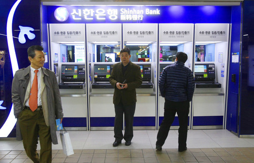Depositors leave after checking their accounts through automated teller machines of Shinhan Bank at a subway station as the bank's computer networks was paralyzed in Seoul, South Korea, Wednesday, March 20, 2013. Police and South Korean officials were investigating the simultaneous shutdown Wednesday of computer networks at several major broadcasters and banks. While the cause wasn't immediately clear, speculation centered on a possible North Korean cyberattack. (AP Photo/Ahn Young-joon)