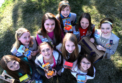 Rick Egan  | The Salt Lake Tribune   Girl Scouts, Front L-R: Addi Fullerton, Rachel Gallegos, Daisy Fullerton, Kennedi Leon. Back L-R: Natalie Pitts, Rae Steinke, Sarah Kendall, Sid Holtz, and Michaela Boyette, Monday, March 18, 2013.  The girl scouts were robbed Saturday when a man grabbed the cash box off the table where they were selling cookies outside of a Taylorsville Wal-Mart.
