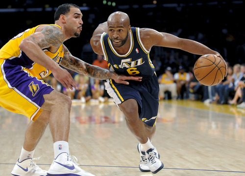 Utah Jazz guard Jamaal Tinsley (6) would rather be playing more, but the 35-year-old point guard says will continue to take advantage of the minutes he gets. (AP Photo/Gus Ruelas)