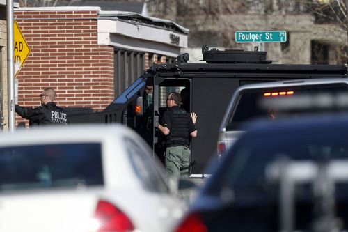 Chris Detrick     The Salt Lake Tribune Law enforcement officers near the scene of a shooting at 1159 S. Foulger Street Tuesday March 19, 2013.