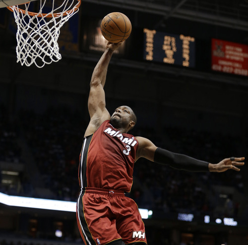 FILE - Miami Heat's Dwyane Wade goes in for a dunk against the Milwaukee Bucks in the second half of an NBA basketball game in this March, 15, 2013 file photo taken in Milwaukee. erry West, Wilt Chamberlain and Goodrich were a Big Three to rival what Miami has, the core of a team that racked up routs on the way to an NBA-record 33 straight victories in the 1971-72 season. (AP Photo/Jeffrey Phelps, File)