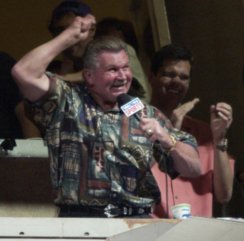 """Former Chicago Bears player and coach Mike Ditka sings """"Take Me Out to the Ball Game"""" during the seventh-inning stretch of a Chicago Cubs baseball game at Wrigley Field in Chicago. Da Coach is a Pitt grad.  (AP Photo/Brian Kersey, File)"""