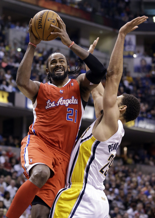 Clippers center Ronny Turiaf, left, helped establish Gonzaga as a power during his time in Spokane. (AP Photo/Michael Conroy)