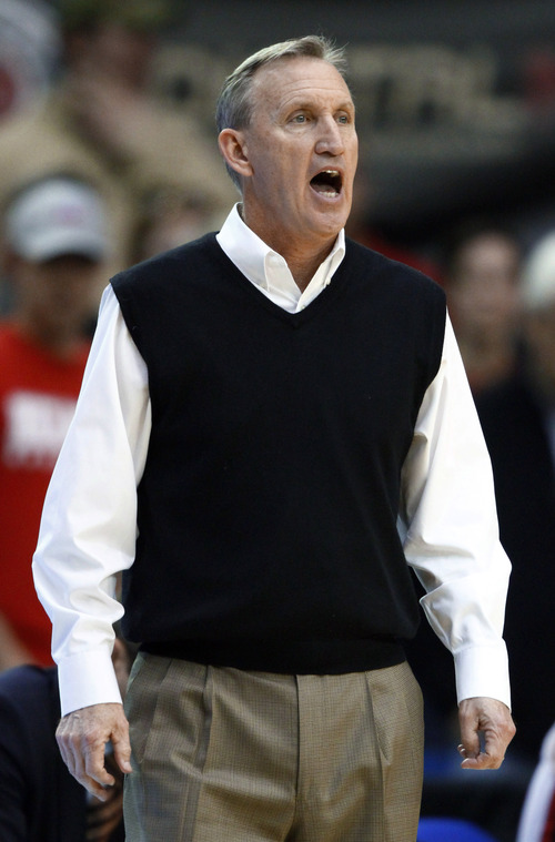 Belmont coach Rick Byrd yells to his team during overtime of an NCAA college basketball game against Murray State in the Ohio Valley Conference men's tournament championship game Saturday, March 9, 2013, in Nashville, Tenn. Belmont won in overtime, 70-68. (AP Photo/Wade Payne)