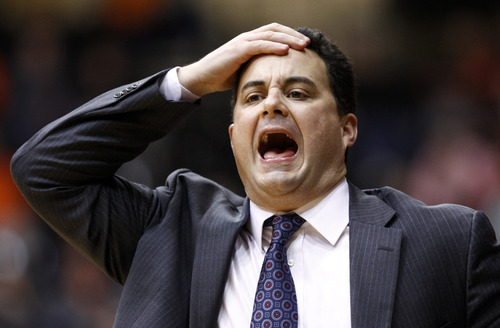 FILE - In this Jan. 12, 2013 file photo, Arizona coach Sean Miller reacts to a call during the second half of an NCAA college basketball game against Oregon State in Corvallis, Ore. Miller developed an intensity that helped him become a Division I point guard and one of the best coaches in the country. (AP Photo/Don Ryan, File)