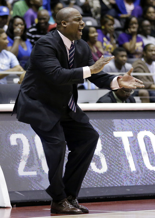 Southern head coach Roman Banks instructs his team in the first half of an NCAA college basketball game against Prairie View A&M in the NCAA college basketball championship game of the Southwestern Athletic Conference tournament, Saturday, March 16, 2013, in Garland, Texas. (AP Photo/Tony Gutierrez)