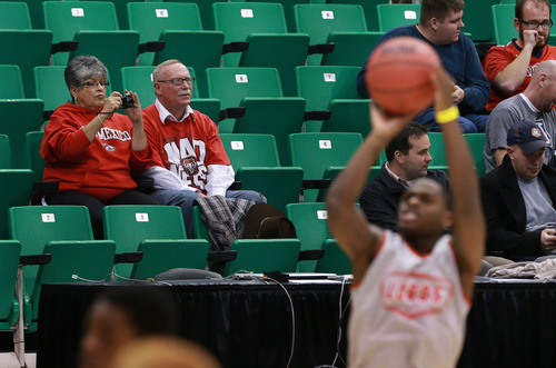 Scott Sommerdorf   |  The Salt Lake Tribune Chuck and Loretta Reynolds from Albuquerque watch from teh stands as the New Mexico Lobos practice at Energy Solutions Arena, Wednesday, March 20, 2013.