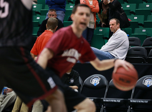 Scott Sommerdorf   |  The Salt Lake Tribune Utah's head basketball coach Larry Krystkowiak watches from the seats as Harvard practices at Energy Solutions Arena, Wednesday, March 20, 2013.