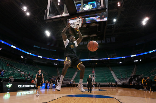Scott Sommerdorf   |  The Salt Lake Tribune Wichita State C Ehimen Orupke dunks during Wichita State's practice at Energy Solutions Arena, Wednesday, March 20, 2013. The Shockers play Pittsburgh in tomorrow's opening round game.