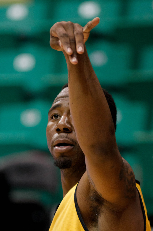 Trent Nelson  |  The Salt Lake Tribune Wichita State's Tekele Cotton (32) shoots the ball as the Wichita State Shockers practice the day before their second round matchup with the Pittsburgh Panthers in the NCAA Men's Basketball tournament, Wednesday March 20, 2013 in Salt Lake City.