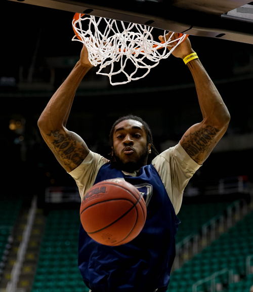 Trent Nelson  |  The Salt Lake Tribune Pittsburgh's Aron Nwankwo dunks the ball as the Pittsburgh Panthers practice the day before their second round matchup with Wichita State in the NCAA Men's Basketball tournament, Wednesday March 20, 2013 in Salt Lake City.