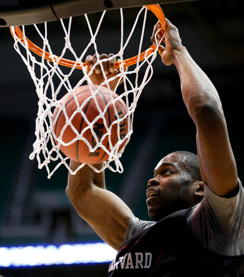 Trent Nelson  |  The Salt Lake Tribune Harvard's Steve Moundou-Missi dunks the ball as Harvard practices the day before their second round matchup with New Mexico in the NCAA Men's Basketball tournament, Wednesday March 20, 2013 in Salt Lake City.