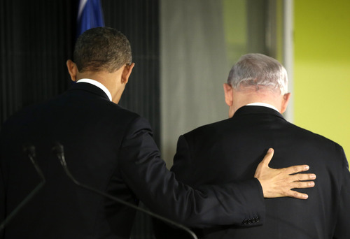 President Barack Obama, left, puts his hand on Israeli Prime Minister Benjamin Netanyahu as they walk out together following their joint news conference in Jerusalem, Israel,Wednesday, March 20, 2013. (AP Photo/Pablo Martinez Monsivais)