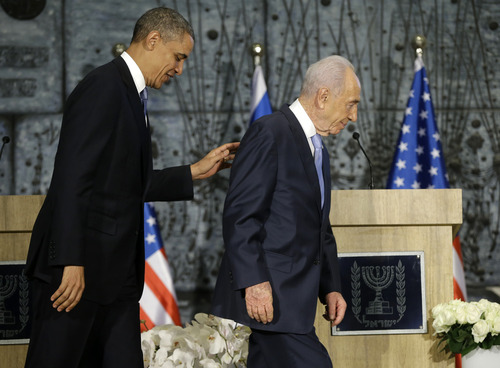 President Barack Obama and Israeli President Shimon Peres walk off stage following their joint statement to members of the media at the President's Residence in Jerusalem, Israel, Wednesday, March 20, 2013, (AP Photo/Pablo Martinez Monsivais)