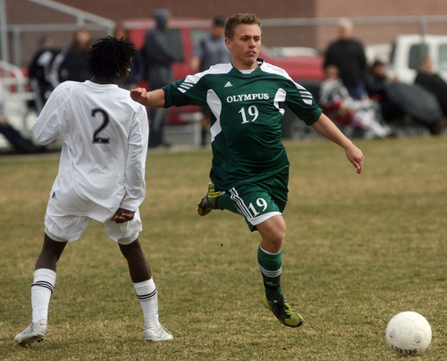 Steve Griffin | The Salt Lake Tribune   Olympus forward Jaden Olson runs past Highland's Tennyson George as he chases after the ball during soccer game at Highland High School in  Salt Lake City, Utah Wednesday March 20, 2013.