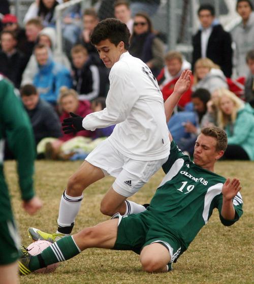 Steve Griffin   The Salt Lake Tribune   Highland's Carlos Mardoniz gets tackled by of Olympus defender Jaden Olson during soccer game at Highland High School in  Salt Lake City, Utah Wednesday March 20, 2013.