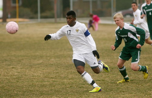 Steve Griffin | The Salt Lake Tribune   Highland's Xavier Jordan sprints after the ball as Olympus defender Dylan Maynes gives chase during soccer game at Highland High School in  Salt Lake City, Utah Wednesday March 20, 2013.