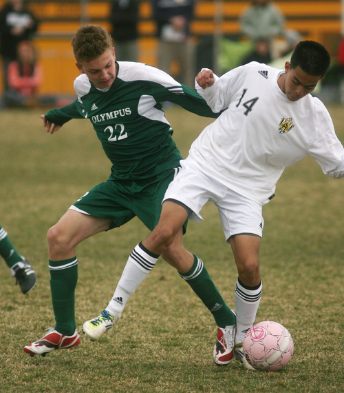 Steve Griffin | The Salt Lake Tribune   Highland's Kyis Orozco, right, and of Ben Anderson, of Olympus, battle for the ball  during soccer game at Highland High School in  Salt Lake City, Utah Wednesday March 20, 2013.