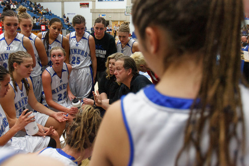 Trent Nelson  |  The Salt Lake Tribune Bingham coach Rand Rasmussen and assistant Charron Mason talk to the team during a timeout in the Class 5A state semifinal against Layton.