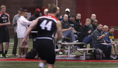 Leah Hogsten  |  The Salt Lake Tribune Utah's Dave Kruger runs the 40 in front of several watchful eyes. University of Utah football players go all out in front of NFL scouts, Wednesday, March 20, 2013 during Utah's Pro Day.