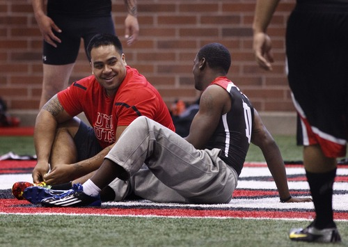 Leah Hogsten  |  The Salt Lake Tribune Utah defensive lineman Star Lotulelei and wide receiver DeVonte Christopher share a laugh in between performances. University of Utah football players go all out in front of NFL scouts, Wednesday, March 20, 2013 during Utah's Pro Day.