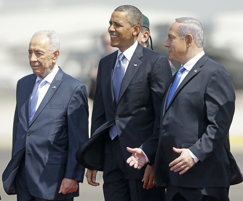 President Barack Obama is greeted by Israeli President Shimon Peres, left, and Israeli Prime Minister Benjamin Netanyahu upon his arrival ceremony at Ben Gurion International Airport in Tel Aviv, Israel, Wednesday, March 20, 2013, (AP Photo/Pablo Martinez Monsivais)
