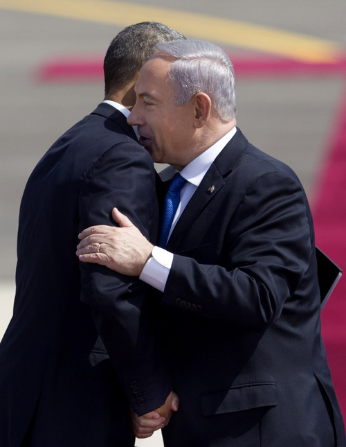 US President Barack Obama, left, and Israel's Prime Minister Benjamin Netanyahu shake hands after Netanyahu's speech during a welcoming ceremony upon Obama's arrival at Ben Gurion airport near Tel Aviv, Israel, Wednesday, March 20, 2013. President Barack Obama is declaring common cause with Israel, highlighting the bonds between the United States and its Mideast ally. He says he has made Israel the first stop of the first trip of his second term to restate his commitment to Israel's security. (AP Photo/Ariel Schalit)