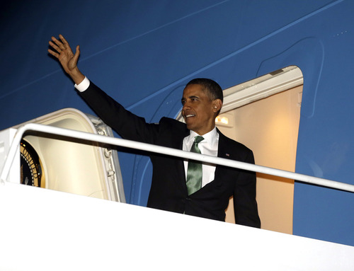 President Barack Obama waves as he boards Air Force One during his departure from Andrews Air Force Base, Md., Tuesday, March 19, 2013. (AP Photo/Pablo Martinez Monsivais)