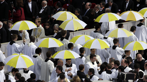 Priests attend Pope Francis' installation Mass in St. Peter's Square at the Vatican, Tuesday, March 19, 2013. Pope Francis has urged princes, presidents, sheikhs and thousands of ordinary people gathered for his installation Mass to protect God's creation, the weakest and the poorest of the world. (AP Photo/Andrew Medichini)